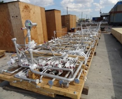 Container skid packing layered pipe spools